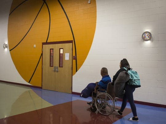 David Solano and his daughter Julia Solano,11, arrive at basketball practice at Raul H. Castro Middle School.