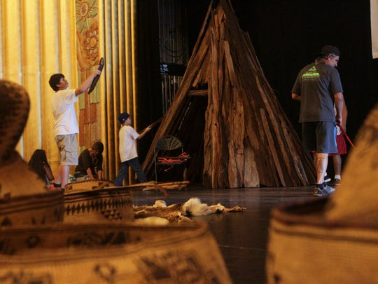 Local American Indians build a traditional bark house on Oct. 17, 2015 before the Indigenous People's History Day Show and Street Fair in the Cascade Theatre.