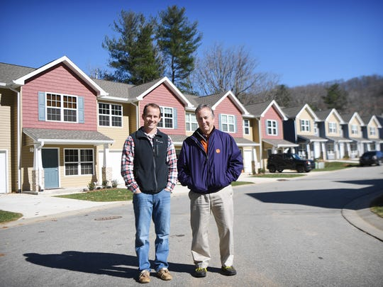 Son and father team Kevin and Ken Jackson pose in the finished and occupied portion of their development Mills Creek Condominiums on Monday, Nov. 20, 2017. The Jackson family has been building and developing properties in Western North Carolina for five generations.