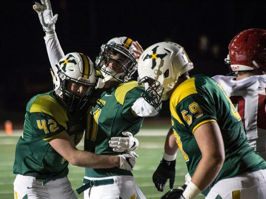 St. X QB Jack Albers celebrates his 1-yard touchdown