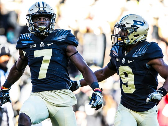 Purdue's Eddy Wilson (7) and Lorenzo Neal celebrate