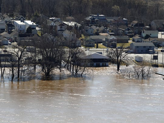 The Ohio River floods along Kentucky 8 in Ludlow on March 15, 2015. The Ohio River measured at 57.7 feet at 5 a.m. - 5 feet above flood stage.