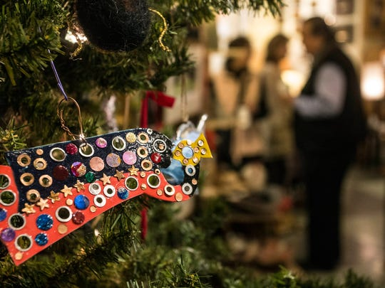 A tree dressed with hand crafted ornaments attracted holiday shoppers into Edenside Gallery during the 32nd Annual Bardstown Road Aglow on Saturday night. 12/2/17