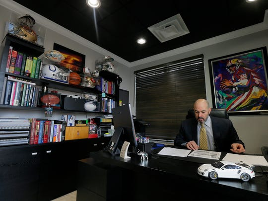 Dr. Frank J. Mandarino, a 25-year veteran who has three Mandarino Chiropractic locations in New York and one in Marlboro, works in his office at his practice on Route 79 in Marlboro, NJ Monday, December 4, 2017.
