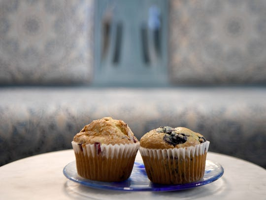 A blueberry and cranberry orange muffin baked fresh at North Star Bakehouse in West Asheville.