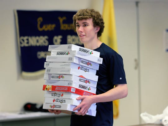 Karl Bischoff, 18, collects and sorts toys with members