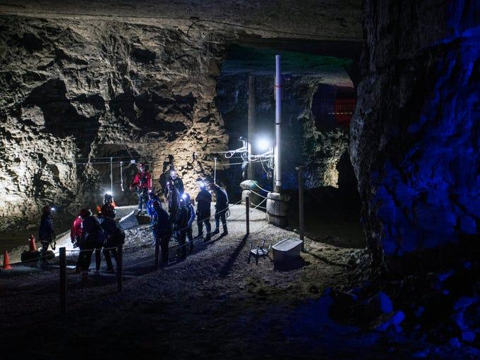 Louisville Mega Cavern explorers don mining helmets