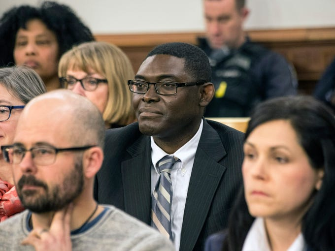 Vitalis Lanshima listens along with other District