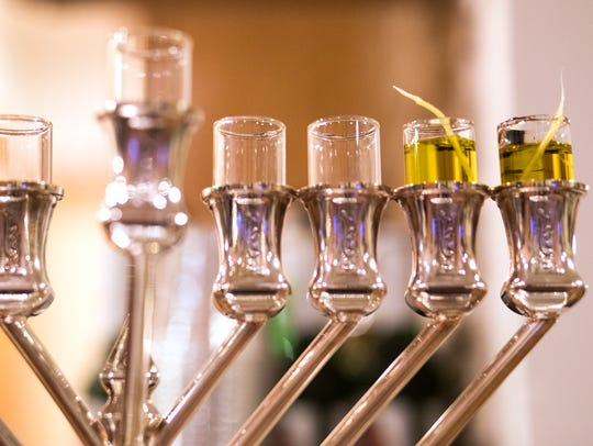 Menorah candles, with olive oil fueled wicks, are seen