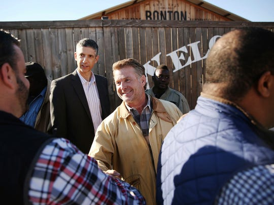 Daron Babcock, founder of Bonton Farms, shakes hands with Adam McGough, Dallas City Council member from District 10, during a groundbreaking and check donation ceremony for the market at Bonton Farms in the Bonton neighborhood in Dallas Tuesday, Dec. 12, 2017. The neighborhood of Bonton, which is within a food desert, will now have a market with a cafe and classes for residents on preparing food and nutrition. AT&T donated $100,000 to the project.