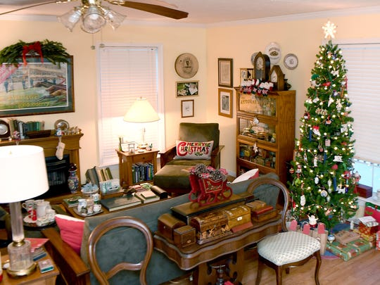 "The living room of Susan and Paul Purdue's home, named Tyrconnell, is filled with decorations for the holiday season. Susan is picky about the ornaments that she displays in her home. ""No glitter, no sequins, no iridescent, and no plastic,"" she said stating that it gets harder and harder each year to find ornaments that meet her standards."