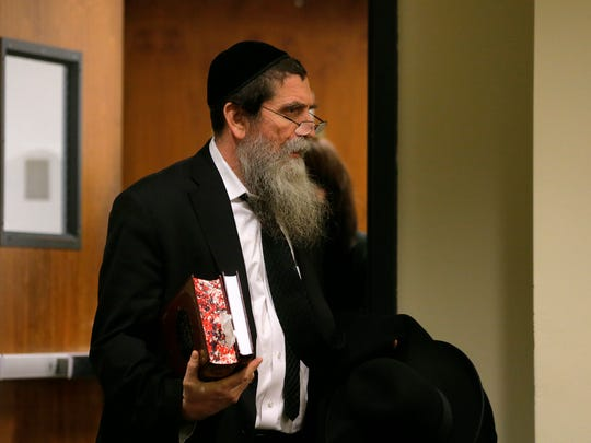 Lakewood Rabbi Osher Eisemann, formerly head of SCHI school and charged with stealing $630,000 in public tuition funds, appears at his hearing before Judge Benjamin Bucca at Middlesex County Courthouse in New Brunswick, NJ Wednesday, December 20, 2017. Judge Bucca would not reconsider a ruling upholding the validity of search warrants in the case against Rabbi Osher Eisemann.