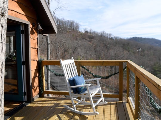 The Serenity Treehouse features both a lower and upper porch from which to enjoy mountain views.