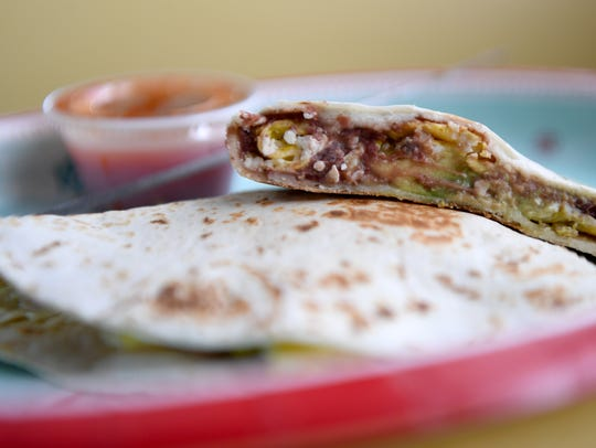 The baleada is a common street food in Honduras. At Latin Grill in Fort Myers, the hearty dish starts at just $2.