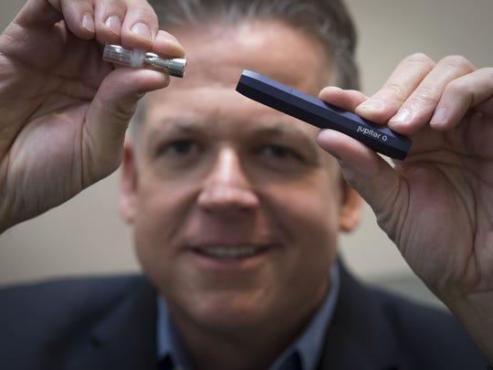 Jupiter Research CEO Mark Scatterday holds one of his company's vaping pens.