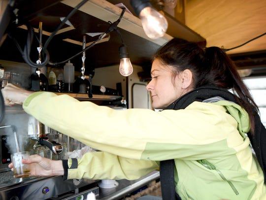 Jennifer Pauer cleans her espresso machine inside of