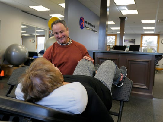 Dr. David Bertone works with Angela Kinlin of Colts Neck at his db Orthopedic Physical Therapy location in Lincroft, NJ Wednesday January 3, 2018.