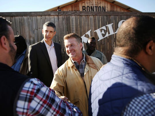 Daron Babcock, founder of Bonton Farms, shakes hands with Adam McGough, Dallas City Council member from District 10, during a groundbreaking and check donation ceremony for the market at Bonton Farms in the Bonton neighborhood in Dallas.