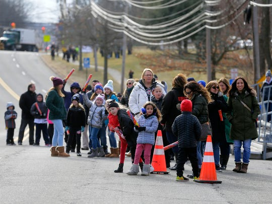 A crowd waits for the Hanover Tigers Junior Pee Wee football team, who are the 2017 Pro Football Hall of Fame Junior Pee Wee National Youth Champions, to arrive as they are celebrated with a parade along North Jefferson Road from the Birchwood Manor to the Hanover Township Community Center in Whippany, NJ Monday January 15, 2018.
