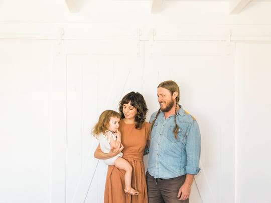 Andy Gassaway (right), Geneva Karwoski (middle) and Prairie Rae at their home in Joshua Tree