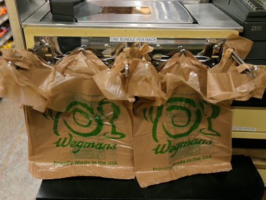 Bundles of plastic bags are placed at the end of a check-out line at Wegmans in Ocean Township.
