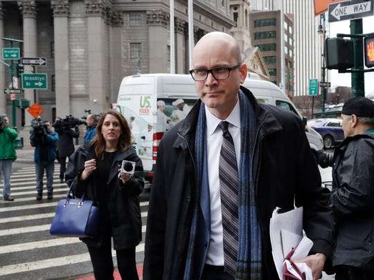 David Patton, a federal public defender, walks out of federal court, Tuesday, Jan. 23, 2018 in New York. Patton is defending Sayfullo Saipov, charged with  using a rental truck to kill eight people in a Halloween attack on a New York City bike path. (AP Photo/Mark Lennihan)