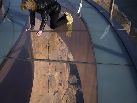 Susan Allen, who is afraid of heights, looks down on