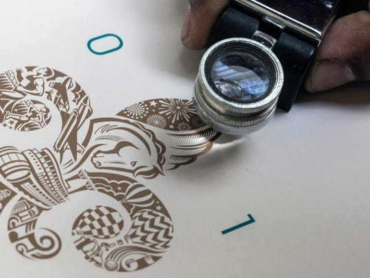 A magnifying glass is used at Clark and Riggs Printing
