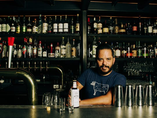 Truss & Twine bar manager Dave Castillo pours Angostura
