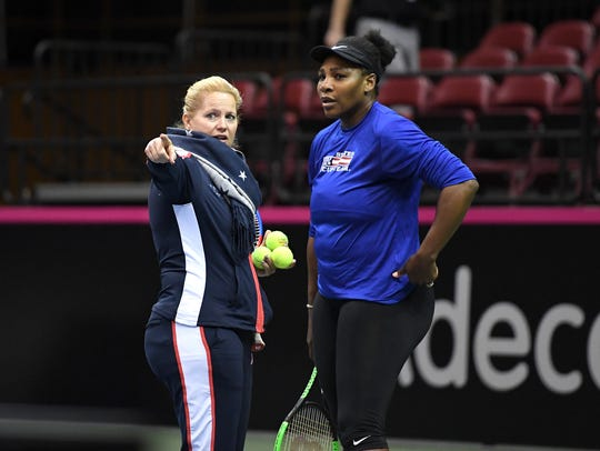 Serena Williams talks with U.S. Fed Cup Captain Kathy