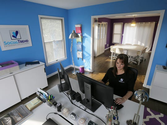 Dawn Malinowski, who owns SocialTrend Marketing Solutions, works in her home office in Toms River.