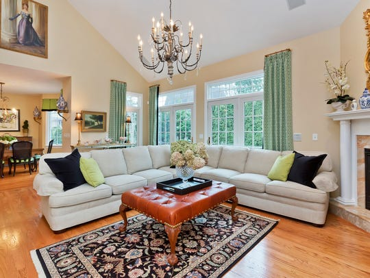 The living room features hardwood flooring and a set of French Doors.