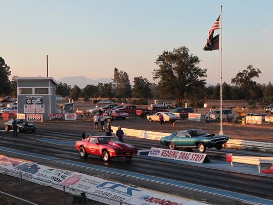 Cars race Aug. 3, 2013, at the Redding Dragstrip.