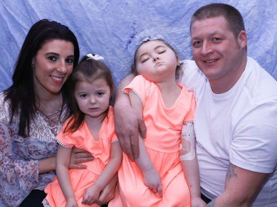 A photo of the Waeghe/DiPonzio family, taken a few days before Lilly Waeghe (second from right) died on Feb. 13, 2018.  From left, Krystin DiPonzio, Riley Waeghe, 4, Lilly, 7, and Lucas Waeghe.
