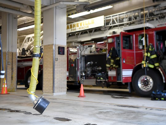 A plymovent hangs from the ceiling of the Asheville Fire Department station 1 downtown. The device attaches to the exhaust pipe of the fire trucks so firefighters won't have to breathe the exhaust from the trucks while they are running inside of the station.
