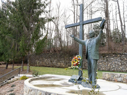 A wreath sits below at statue of the Rev. Billy Graham outside of the Ridgecrest Conference Center on Wednesday, Feb. 21, 2018. Rev. Graham died at his home in Montreat Wednesday morning.