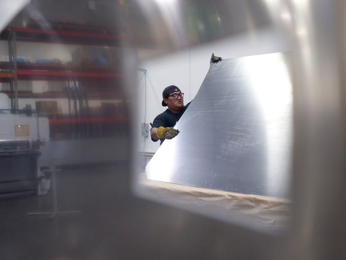 Derrick Moline bends a piece of aluminum on Feb. 5,