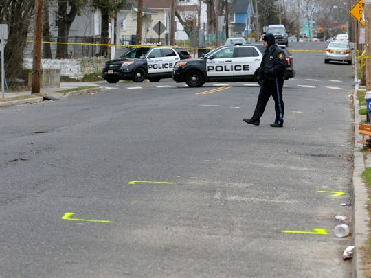 The scene of the fatal shooting of a 10-year-old boy at 405 Ridge Avenue, near the corner of Summerfield Avenue,  in Asbury Park, NJ Thursday February 22, 2018.