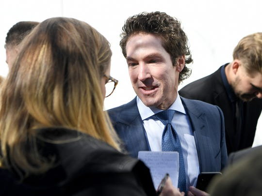 Televangelist Joel Osteen talks with members of the media before the private funeral service for Billy Graham in a tent outside the Billy Graham Library in Charlotte, N.C. on Friday, March 2, 2018.