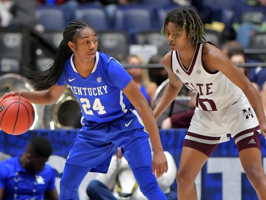 Kentucky Wildcats guard Taylor Murray (24) controls the ball against Mississippi State Lady Bulldogs guard Jazzmun Holmes (10) during the second half of game seven at Bridgestone Arena. Mississippi State won 81-58. Mandatory Credit: Jim Brown-USA TODAY Sports