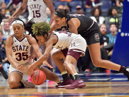 Mar 4, 2018; Nashville, TN, USA; Mississippi State Lady Bulldogs guard Jazzmun Holmes (10) goes for the loose ball assisted by Lady Bulldogs guard Victoria Vivians (35) against South Carolina Gamecocks forward A'ja Wilson (22) during the second half of the SEC Conference Tournament championship game at Bridgestone Arena. South Carolina won 62-51. Mandatory Credit: Jim Brown-USA TODAY Sports