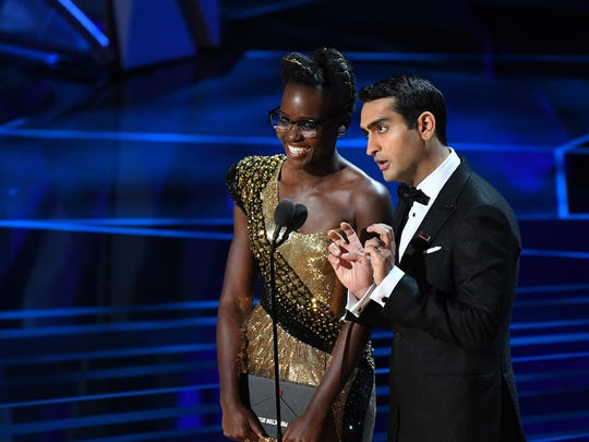 March 4, 2018; Hollywood, CA, USA; Lupita Nyong'o and Kumail Nanjiani present the Oscar for achievement in production design during the 90th Academy Awards at Dolby Theatre.
