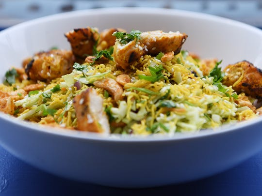 The Desi Salad, shown here topped with Chicken Tikka,