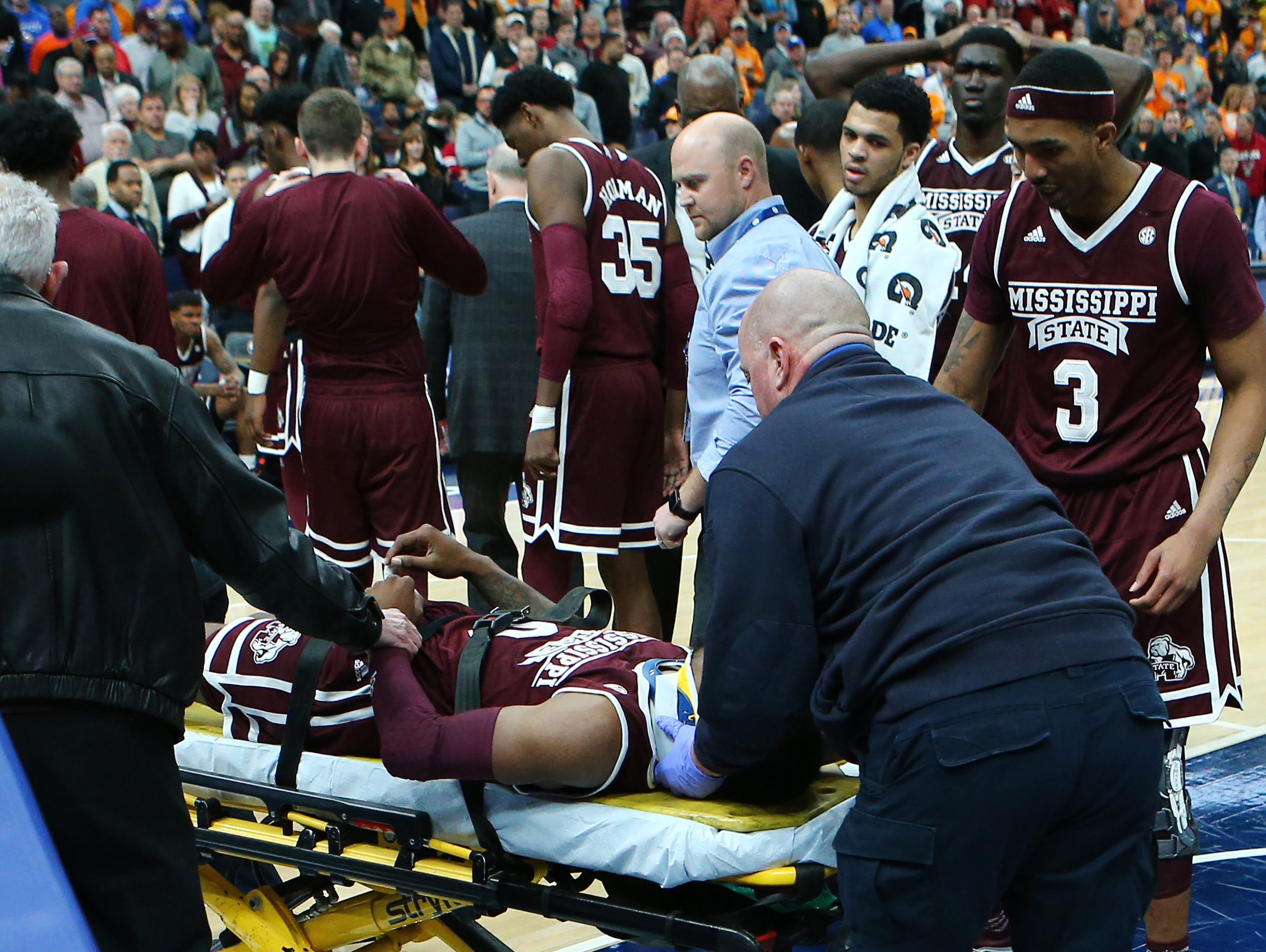 Mar 9, 2018; St. Louis, MO, USA; Mississippi State Bulldogs guard Nick Weatherspoon (not pictured) is take off the court on a stretcher after suffering an apparent injury during the second half against the Tennessee Volunteers in the quarterfinals of the SEC Conference Tournament at Scottrade Center. Mandatory Credit: Billy Hurst-USA TODAY Sports