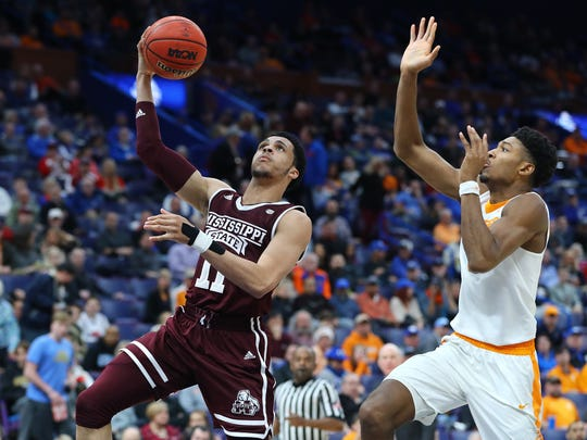 Mar 9, 2018; St. Louis, MO, USA; Mississippi State Bulldogs guard Quinndary Weatherspoon (11) shoots against Tennessee Volunteers forward Kyle Alexander (11) during the second half of the quarterfinals of the SEC Conference Tournament at Scottrade Center. Mandatory Credit: Billy Hurst-USA TODAY Sports