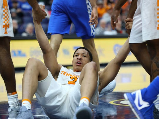 Tennessee Volunteers forward Grant Williams (2) is helped up by teammates in the SEC tournament title game against Kentucky.