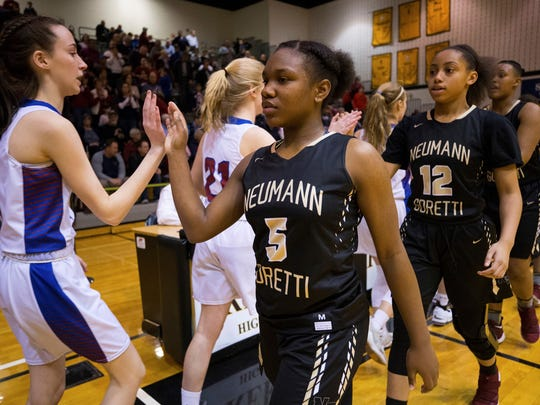 Neumann-Goretti High School's Diamond Johnson (5) was at the center of heated debate over PIAA transfer rules during the 2018 basketball season. AP FILE PHOTO