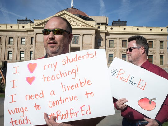 Tim Moran Jr. (left), a teacher at Villa de Paz Elementary School who called in sick March 21, 2018, protests at the Arizona state Capitol.