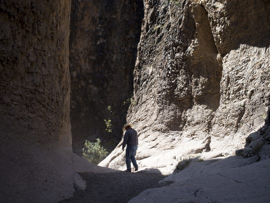 Nick Havlik of Texas State Parks walks down a trail