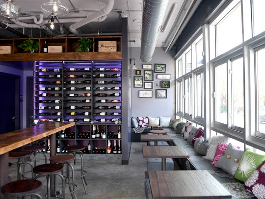 "Rustic Grape Wine Bar is now open on the corner of South Lexington Avenue and Aston Street in the same building as the Aloft Hotel. The owners describe the space as a ""wine nook"" and also serve some breads, cheeses, meats and sweets to compliment the drinks."